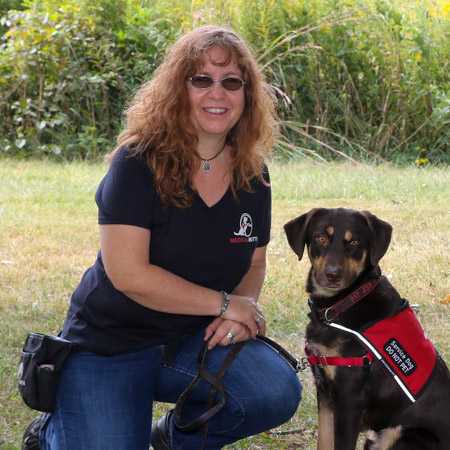 Medical Mutts founder Jennifer Cattet Ph.D. pictured with a rescue service dog.